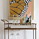 "Victoria painted this butterfly in a retro color palette. ""I wanted to create a piece that would tie in with the dining area (where it becomes a bit more midcentury and less art deco) and also make sure it was a statement piece,"" she explains."