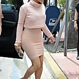 Kim Kardashian's pastel-hued set packed a sophisticated punch, thanks to a mock-turtleneck and slim miniskirt.