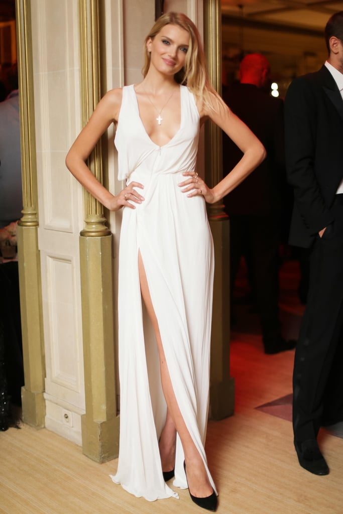 Lily Donaldson showed some skin in a high-slit gown and gold necklace at the Mademoiselle C premiere.