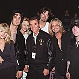 Motley Crue, Pamela Anderson, and Donna D' Errico snapped a photo with Dick Clark during the January 1997 American Music Awards.
