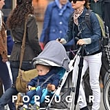 Natalie Portman juxtaposed a dark denim jacket and white jeans while hanging out with son Aleph in LA. A printed scarf broke up the look, while Westward Leaning sunglasses injected further cool.