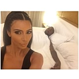 "After Kanye took center stage and performed, the newlyweds headed back to their bedroom, where Kim took an hilarious selfie showing Kanye sleeping in the background. ""Side chicks be like....,"" Kim captioned it.  Source: Instagram user kimkardashian"