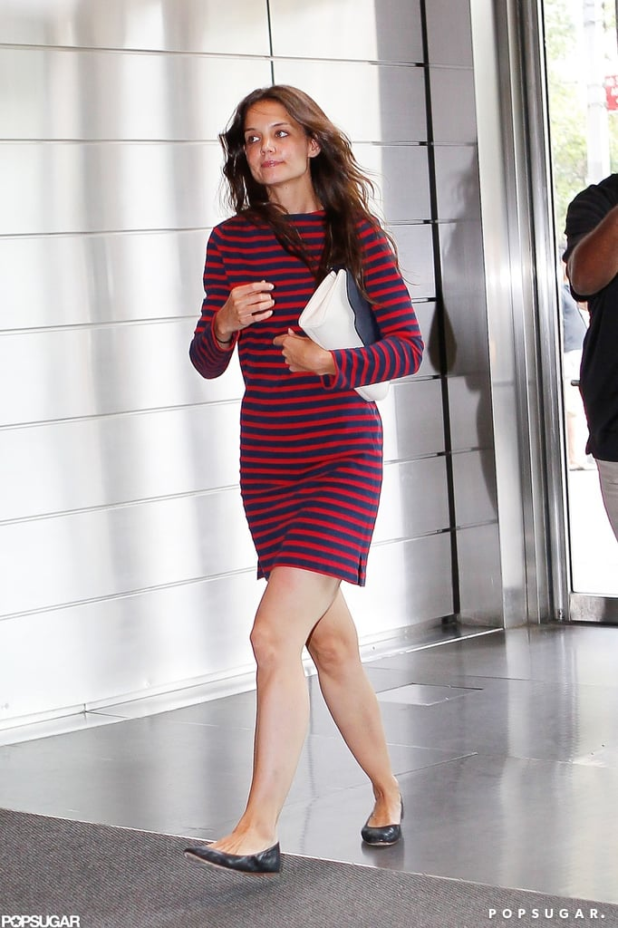 Katie Holmes threw on a striped dress to spend her Saturday out and about in NYC. She was solo to visit an office building for a meeting, then linked up with her daughter Suri and another young family friend to look at the puppies for sale at a pet shop. Katie and Suri are spending the weekend in the Big Apple with their pals and family, including Katie's mom Kathleen Holmes. They're carrying on, while Suri's dad, Tom Cruise, focused on work for the last week. He just wrapped up production on his latest movie, Oblivion, and was able to celebrate the end of shooting with his son, Connor Cruise, in Northern California last night.