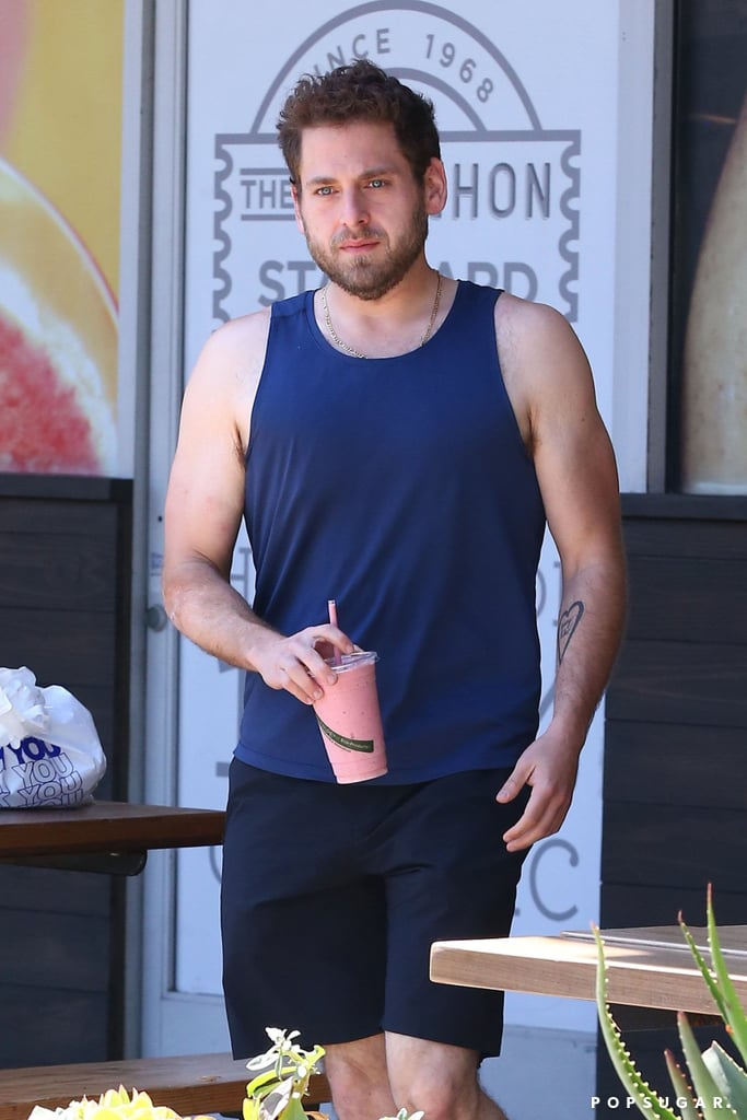 Jonah Hill dropped a substantial amount of weight recently and hasn't been shy about showing off his slimmer figure from coast to coast. Last week, the Wolf of Wall Street actor looked damn near unrecognizable while hitting the streets in a fitted t-shirt in NYC, and on Friday, Jonah was spotted putting his biceps on display in a blue tank top while picking up a smoothie before hitting the gym in LA. Jonah reportedly hired a nutritionist and kept a food journal to lose weight after gaining 40 pounds for his role in the 2015 crime film War Dogs, and also got some fitness advice from his 21 Jump Street costar Channing Tatum.