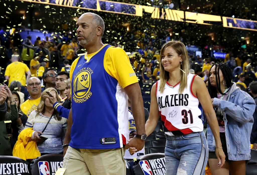 "Parents, going to every one of your kids' games matters, but what happens when both your children are in the NBA? What happens when they're playing each other in the Western Conference Finals? Dell and Sonya Curry are figuring it all out now. For the first time in NBA history, brothers are playing each other in a conference finals matchup with Steph Curry and his Golden State Warriors taking on his younger brother Seth and the Portland Trail Blazers. It has to be a relief for their parents, who have presumably racked up tons of miles flying across the West Coast to be at all the Warriors and Blazers postseason games, but the question of who to root for has left them divided.  Like any sports family, the Currys flipped a coin to see which parent would root for which son during Tuesday night's game. Younger sister Sydel shared the dispute on her Instagram Story, and it had Sonya rooting for Seth and the Blazers and Dell rooting for Steph and the Warriors. But despite the results, both parents represented their talented sons with awesome split jerseys. It's the first time in Seth's professional career that he's made it to the playoffs, and Steph is a three-time NBA champion, but no matter what happens, it's a win-win for the basketball family. ""From our end, to see both of our sons to compete at this level and for the goal to be a championship is such a blessing. We never could imagine this,"" Sonya told ESPN. ""One of them might go home. But we're going to the championship! . . . I actually look forward to watching Seth. I want him to steal the ball and want him to shoot over Stephen and all that good stuff. I want him to have his moments, too. It's such a blessing to just be able to watch this and experience all this."" On Tuesday night, Steph scored 36 points to help the Warriors win game one of the series, and Seth had three points for the Blazers, but it's just game one and we have a lot more Curry family action to look forward to. Ahead, see how Dell and Sonya handled their son's rivalry."