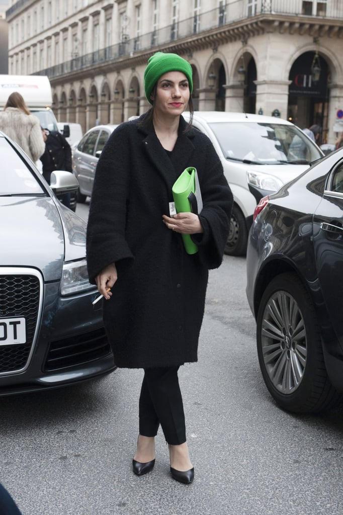 Pops of bright green played up this all-black outfit.