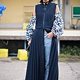 So your maxi dress has a zipper? We dare you to zip it only halfway down so you can style it with low-rise jeans, an over-the-shoulder top, and chunky platforms.