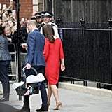 "As they had following the birth of George and Charlotte, Kate and William held hands while walking to their car with newborn Louis. They had the confidence of seasoned pros as William held the car seat casually by his side and Kate walked comfortably in heels.  While the pair didn't give an interview outside of St. Mary's, William did comment to waiting reporters that they were ""very happy"" and ""very delighted"" joking that they ""didn't keep [the press] waiting too long this time."" The parents were clearly conscious of how speedy the whole process had been, but unapologetic."