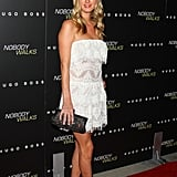 Nicky Hilton toughened up an ultrafeminine white strapless with a pair of Valentino's studded t-strap heels.