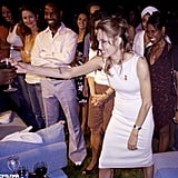 Angelina Jolie partied with Wyclef Jean at a Haiti fundraiser in the Hamptons in August 2005.