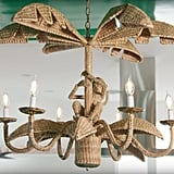 Can we please discuss the gloriousness of this rattan chandelier, complete with a little monkey?