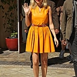 Nicole Richie wore her Spring brights, combining a saffron-hued Thakoon leather minidress with an Etro print belt and House of Harlow 1960 Leigh pumps during a visit to The Grove in March 2012.