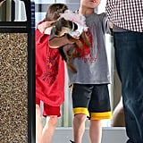 Sean Preston held Hannah as he walked out of the vet's office Sunday with mom Britney Spears.