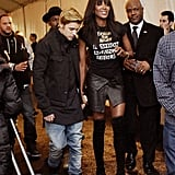 Justin Bieber held hands with Naomi Campbell while making his entrance at her Fashion For Relief event.