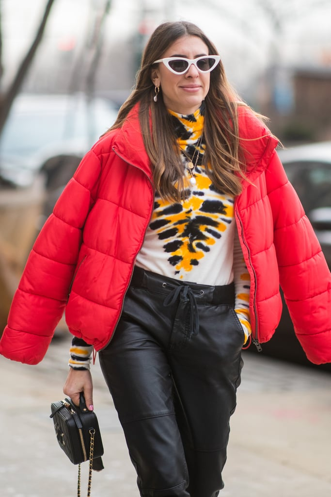 Why settle on only one colourful item when you can mix and match more than one with a tie-dye turtleneck and bright red puffer on top?