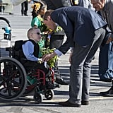 Will bent down to shake hands with a young boy in a wheelchair as the royal couple departed the Yellowknife airport in Canada back in July 2011.