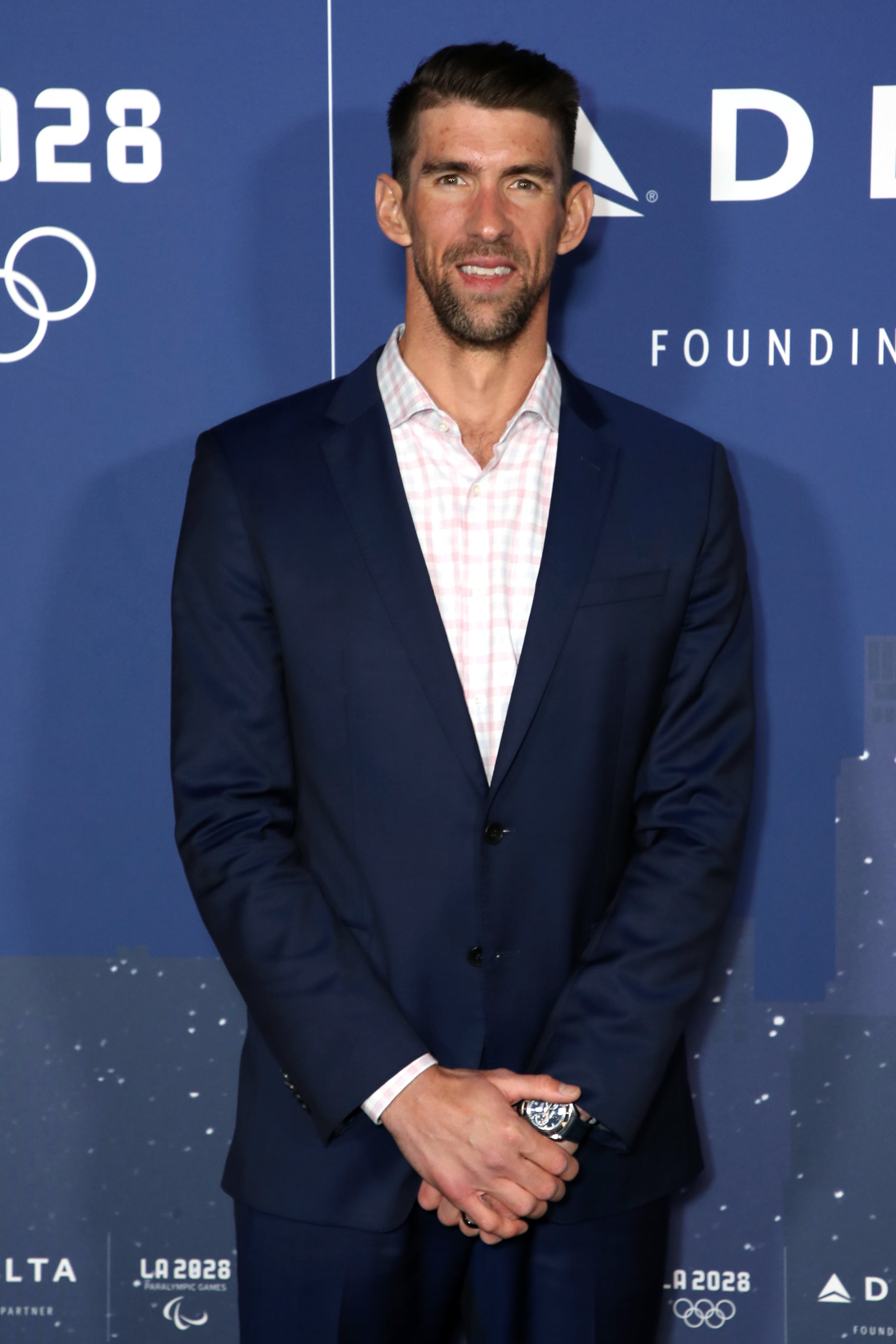 LOS ANGELES, CALIFORNIA - MARCH 02: US Olympian Michael Phelps poses at the event to announce the Founding Partnership between Delta Air Lines and LA28 at Griffith Observatory on March 02, 2020 in Los Angeles, California. (Photo by Joe Scarnici/Getty Images for LA28)