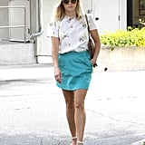 Reese styled the perfect Spring ensemble tucking a floral Band of Outsiders top into a vibrant turquoise skirt then completing the look with nude ankle-strap sandals, coordinating shades, and a tan Valentino bag.