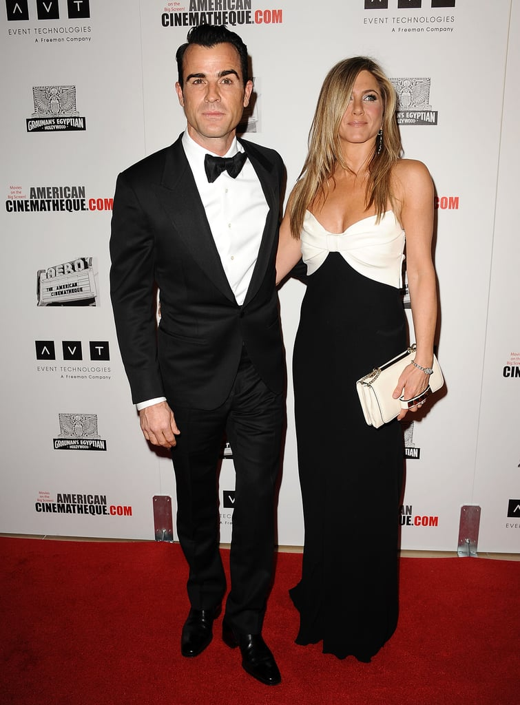 Jennifer Aniston and fiance Justin Theroux wore black and white in LA.