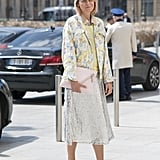Wear a sequined skirt that extends beyond the knee with smart loafers.