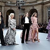 Camila posing alongside (from right to left) Helen Mirren, Amber Heard, Doutzen Kroes, and Liya Kebede.