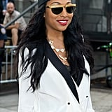 On Melanie Fiona, this turban headband, gilded shades, and red lip combination is reminiscent of '80s rocker chic. All it takes to re-create this look at home is a pair of opaque tights.
