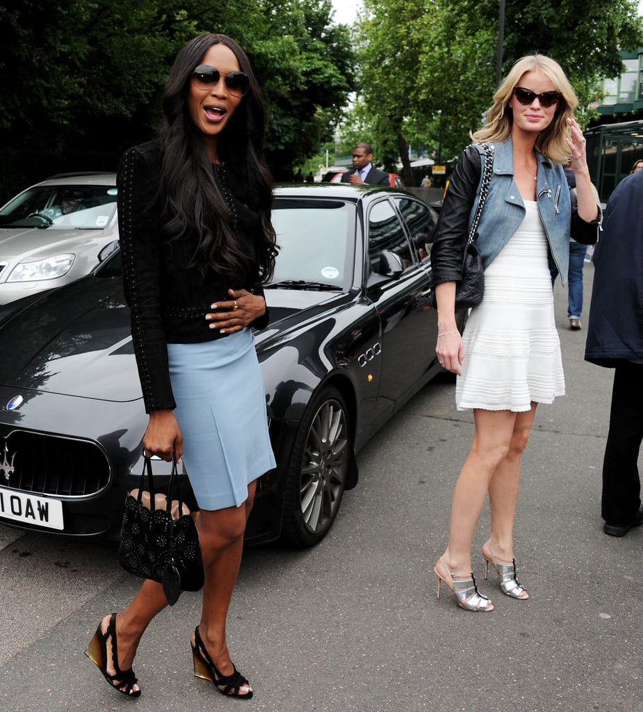 Models Naomi Campbell and Caroline Winberg arrived at Wimbledon both looking chic in their respective looks. Naomi paired black with blue, while Caroline donned a little white dress with a two-toned leather jacket and metallic sandals.