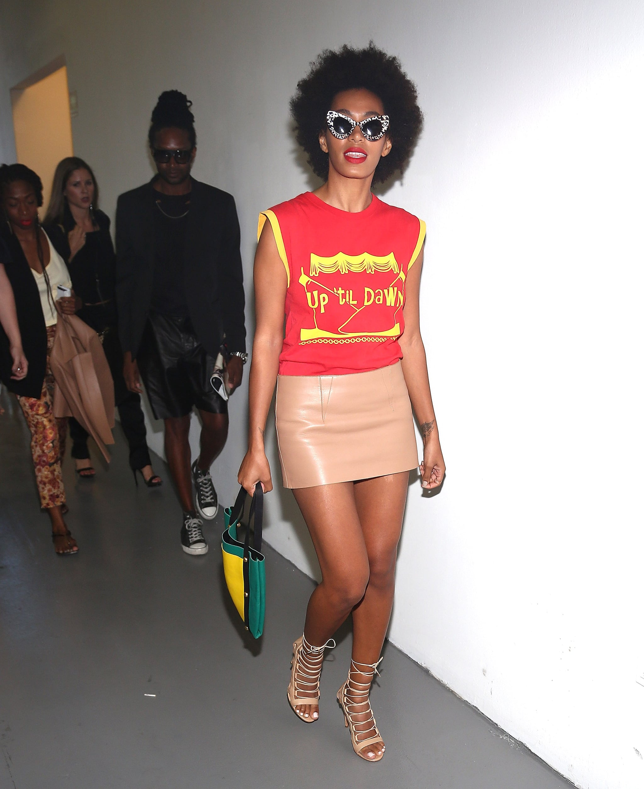 Solange Knowles arrived to Alexander Wang in a bright red-and-yellow graphic top, which she tempered with a nude leather skirt. But we can't forget about the accessories! Get a load of her Zac Posen x Illesteva sunglasses and shoes.