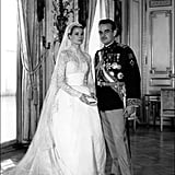 """Every aspect of the ceremony was recorded by MGM, making it one of the first """"reality TV weddings."""" Much like Kim Kardashian's first wedding, Grace and Prince Rainier's nuptials were broadcast for fans back home. It was one of the first of its kind and gave people unheard-of access with shots of Grace blessing herself during the vows and up-close footage of the presentation of the rings.  Grace wore two elaborate gowns. Helen Rose — MGM's head costume designer at the time who'd worked with Grace on High Society and The Swan — created both of Grace's lavish dresses. For the civil ceremony, she donned a pale pink taffeta skirt suit with a champagne lace overlay. The religious ceremony required a more elaborate look.   Grace's second dress was straight out of a fairy tale. With 450 yards of peau de soie, taffeta, silk net, antique Belgian lace, three petticoats, and an enormous train, the ivory gown was, quite literally, fit for a princess (and took 30 seamstresses at the studio six weeks to make!). Both of the ceremony dresses were given to the actress as a wedding gift from studio executives at MGM.  Her wedding gown still serves as inspiration for today's designers. The Alexander McQueen dress designed by Sarah Burton for Kate Middleton took notes from Grace's gown, and Oscar de la Renta later discussed its enduring impact on the fashion world, saying, """"On her wedding day, Grace Kelly gave new meaning to the word icon. Her whole look, from the regal veil to the feminine lace details and the conservative gown, made her an ageless bride.""""   She opted for unique accessories. In lieu of the standard tiara, Grace wore a beaded Juliet cap that attached to her 90-yard veil. Along with a bouquet of lilies of the valley, she carried a pearl-encrusted prayer book. Even her shoes had a little something special to them; shoe designer David Evins hid a copper penny inside the sole of the right shoe as a symbol of good luck."""