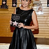 Lauren Conrad promoted her books wearing a black leather dress in LA.