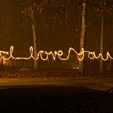 Take a photo at night using time-lapse, and write it out in the sky.