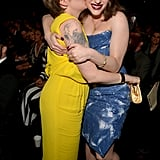 Lena Dunham planted a kiss on Kat Dennings.