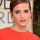 Emma Watson chose a matte pink lip to glam up her piecey low bun.