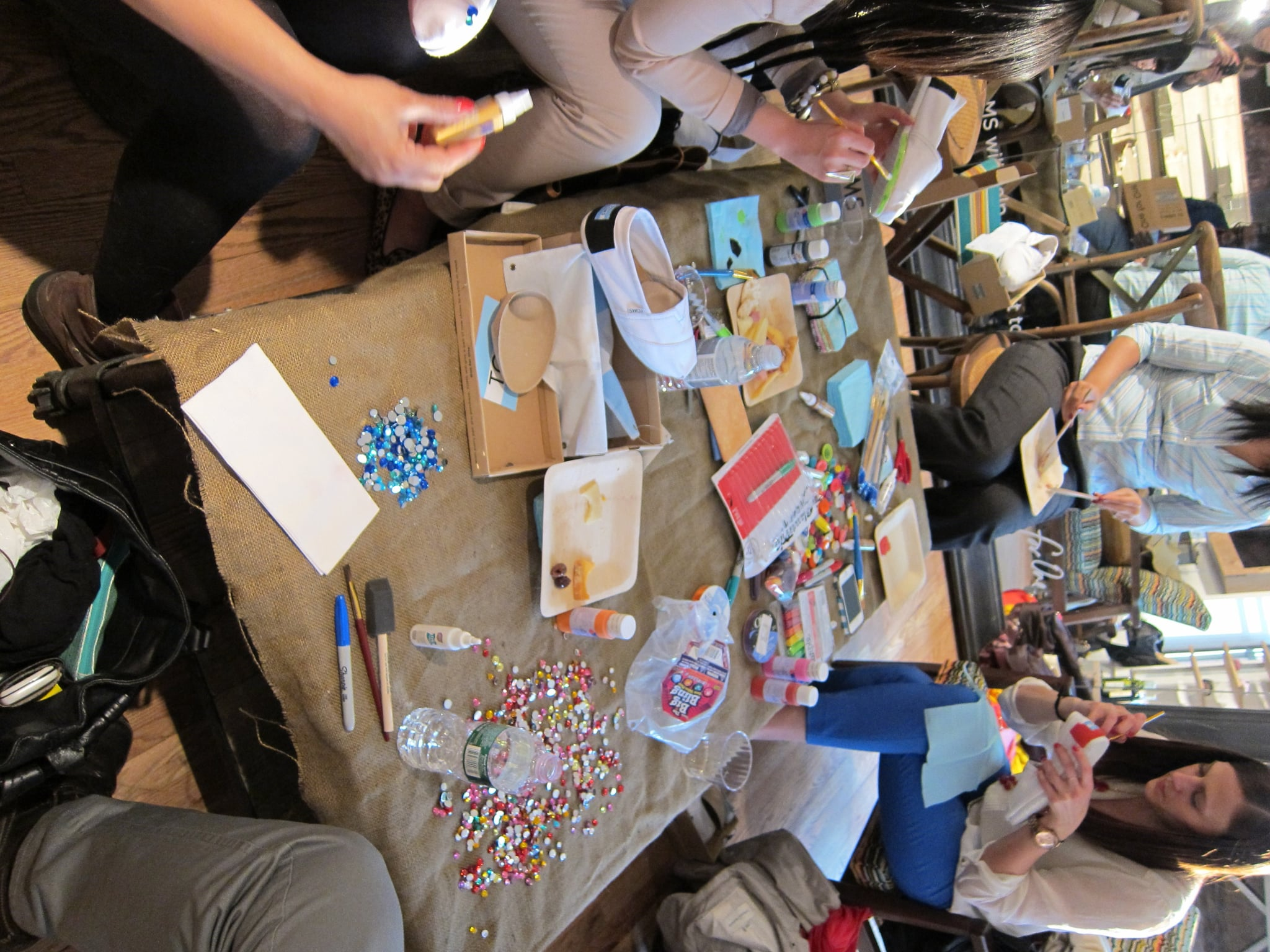 Spotted at TOMS NYC headquarters: lots of crafty ladies putting their personalized spin on a pair of classic TOMS shoes.