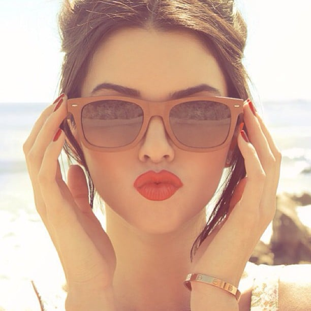 Bold brows, blush, and beautiful lipstick make us wistful for a gorgeous Summer day. Source: Instagram user glamourisforlife