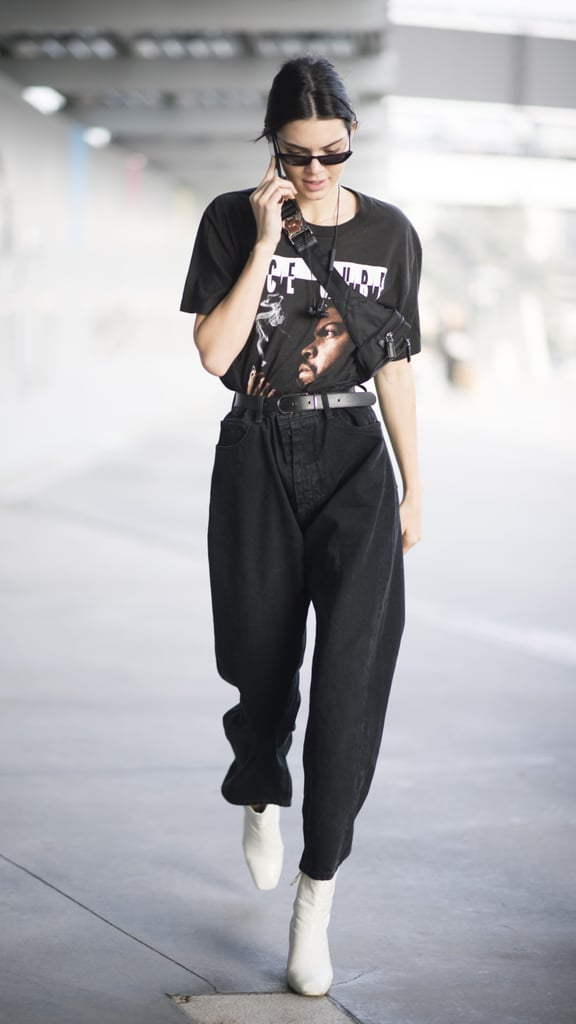 Kendall strapped a nylon black fanny pack around her vintage tee, capping off the look with white mod boots.