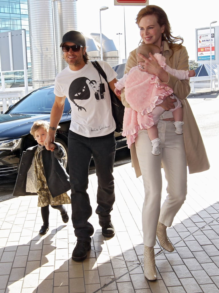 Nicole Kidman carried Faith in her arms while Keith Urban followed behind with Sunday Rose at the airport in Australia today. The family of four headed out of town after a brief stay Down Under. Nicole Kidman arrived in Sydney with Sunday and Faith last week, and the trio spent time with family during their trip. They also had an early celebration for Sunday's third birthday, which is on Thursday. Keith had a few days off from his Get Closer World Tour to join his girls overseas, though he'll be back on stage soon with his next show scheduled for his daughter's big day in PA.