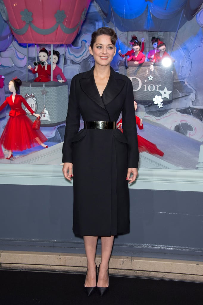Marion Cotillard was the vision of ladylike in her Christian Dior black wool coat from the Fall 2012 Couture collection.