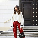 Style an Oversize White Sweater With Bold Red Pants and Designer Sneakers
