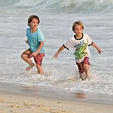 Jayden James and Sean Preston Federline ran in the ocean in Brazil.