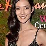 Tao Okamoto opted for a sideswept, vintage style and simple eyeliner.