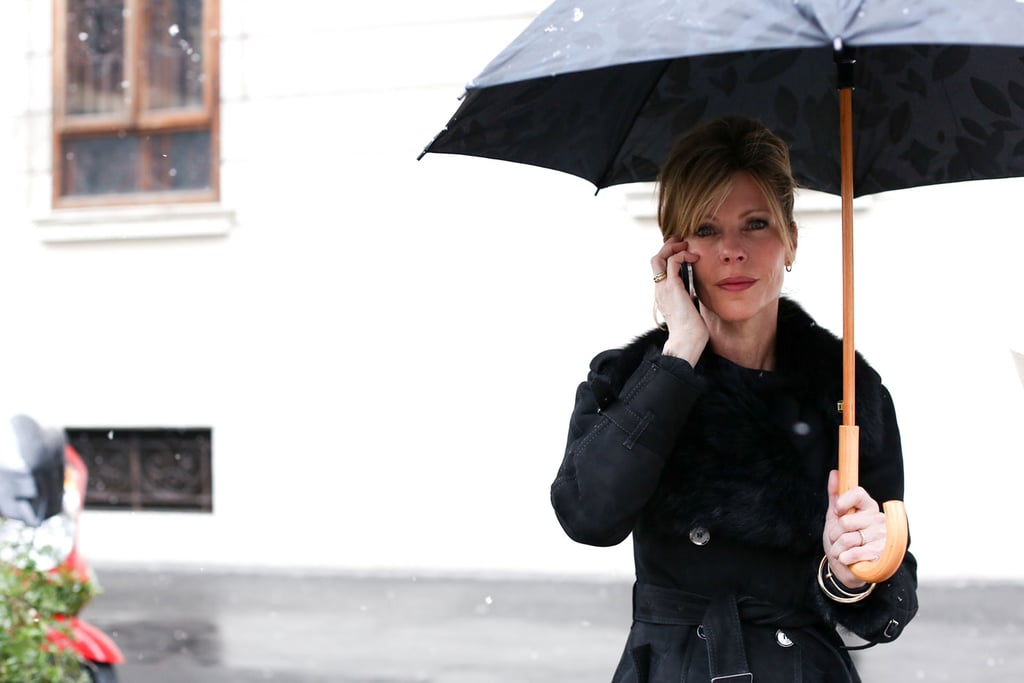 Elle editor in chief Robbie Myers looked put together and chic, even when peering from beneath a big umbrella.