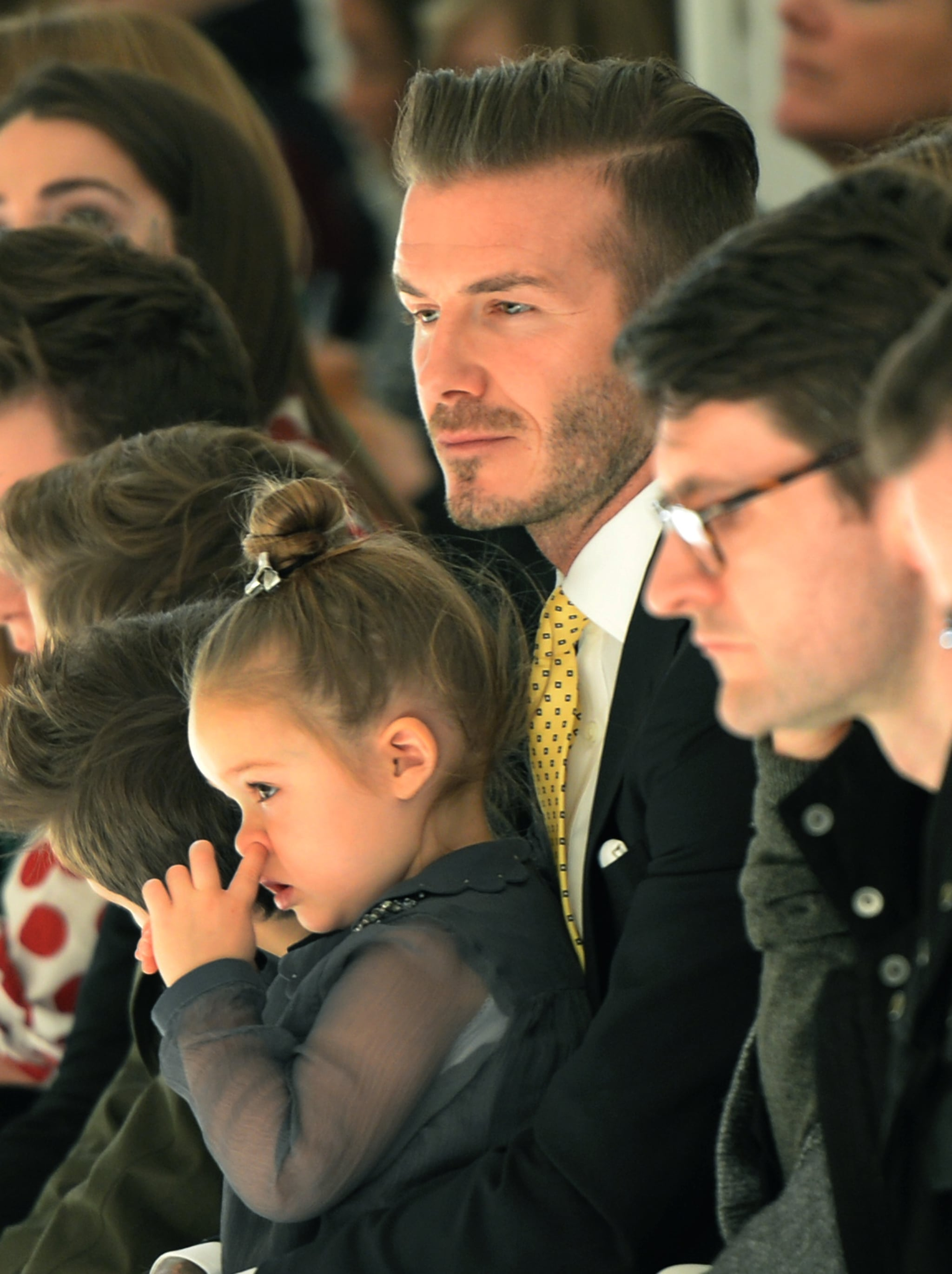 David Beckham held Harper while the father-daughter duo watched Victoria Beckham's fashion show in NYC on Sunday.