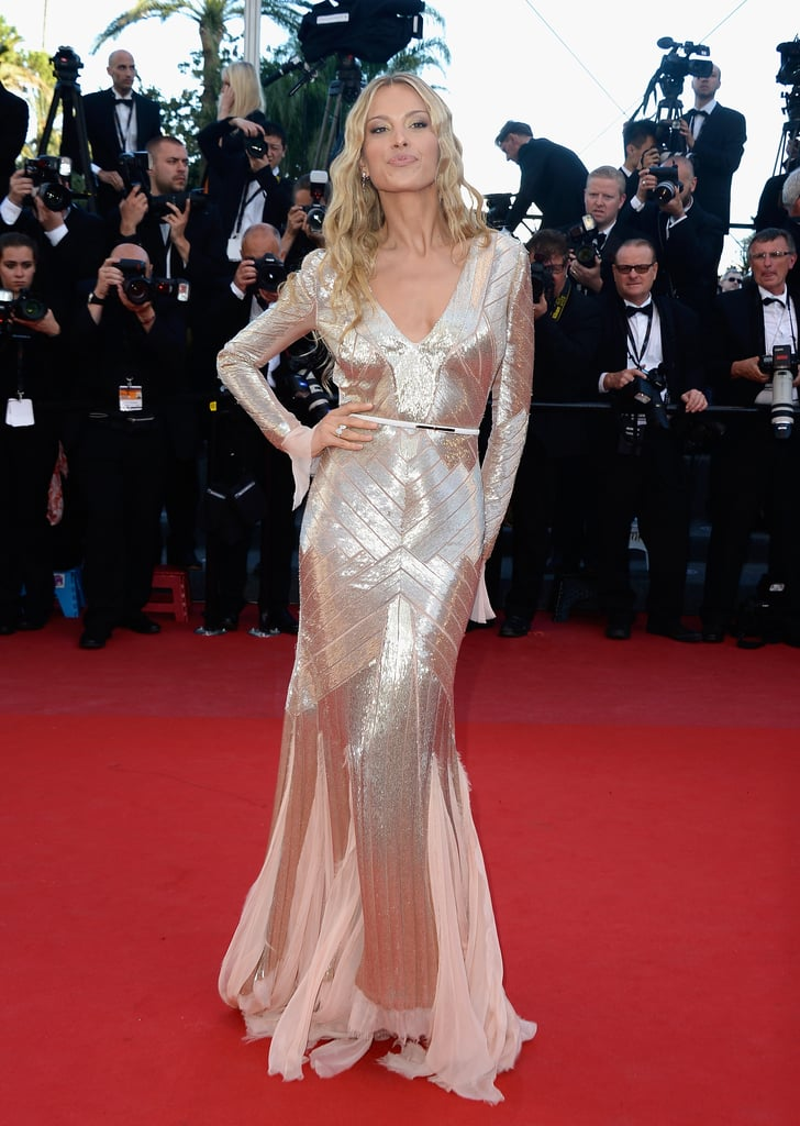Petra Nemcova glowed in a gold-beaded, long-sleeved Emilio Pucci gown, Chopard jewels, and mermaid waves at the Behind the Candelabra premiere.