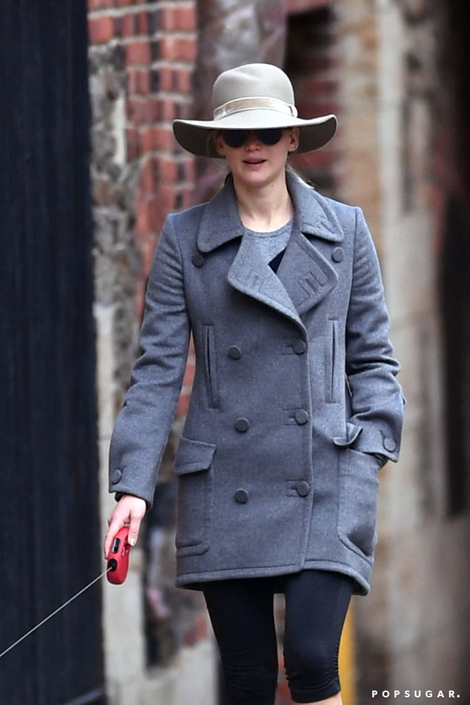 """Jennifer Lawrence was spotted on a casual stroll through NYC with her dog, Pippi, and a friend on Wednesday. The Mother! star kept a low profile in leggings and a gray coat and covered up in a hat and sunglasses. Jennifer's outing came on the same day as reports that she had broken up with her boyfriend of a year, film director Darren Aronofsky. According to a source, the pair amicably split in October but still remain friends; they even sat together at the Governors Awards earlier this month, despite their split.       Related:                                                                                                           43 Celebrity Couples Who Have Broken Up This Year               The 27-year-old actress first began dating the 48-year-old director in Summer 2016. It wasn't until September 2017 that they made their public debut as a couple while attending the premiere of Mother! in NYC. Jennifer opened up about their personal and professional relationship during that time, saying, """"We had energy. I had energy for him. I don't know how he felt about me. When I saw the movie, I was reminded all over again how brilliant he is."""""""