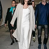 A White Camisole, Pants, and Duster Coat at the Cannes Airport in May 2019