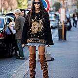 Layer an oversize sweater over a miniskirt and finish with tall boots for drama.
