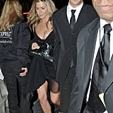 Jennifer was one step behind Justin in her sexy Versace dress.
