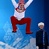 After narrowly avoiding a wardrobe malfunction, Russian bronze medalist Olga Graf jumped for joy following the ladies' 3,000-meter speed skating event.