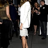 From the side, you get an even better look at Gisele's enviable legs and those gorgeous black evening sandals.